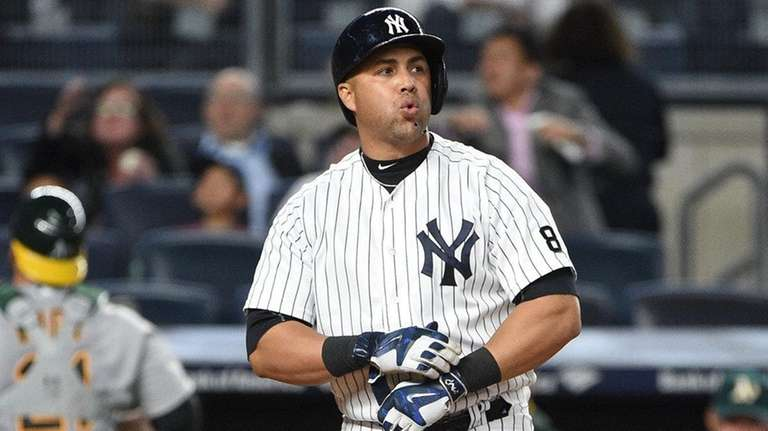 New York Yankees rightfielder Carlos Beltran reacts after
