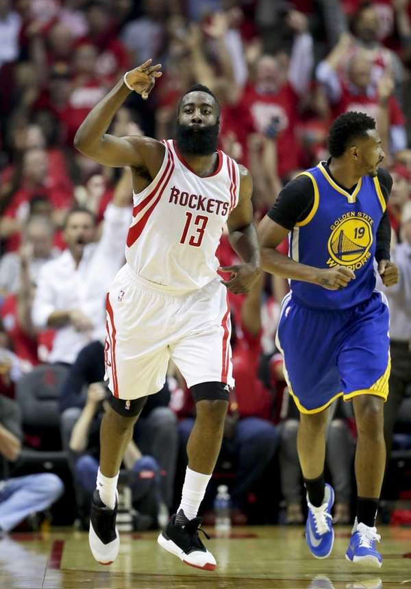 Houston Rockets guard James Harden celebrates a basket