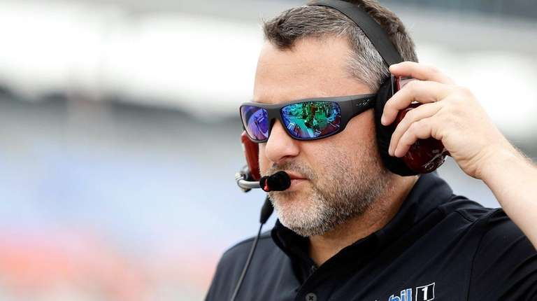 Team owner Tony Stewart stands on the