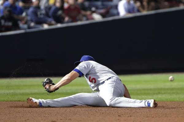 Los Angeles Dodgers shortstop Corey Seager commits a