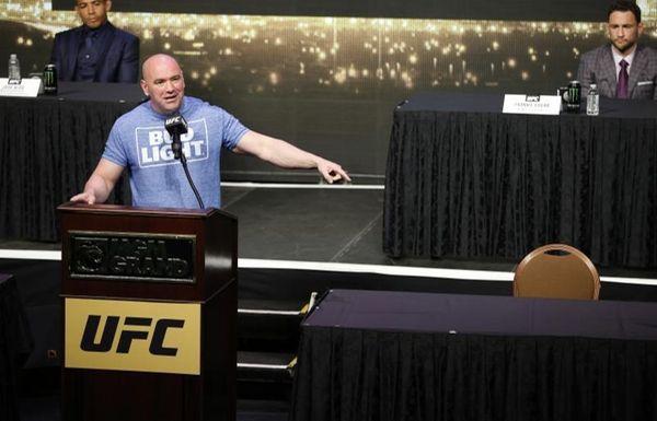 UFC president Dana White speaks beside an empty