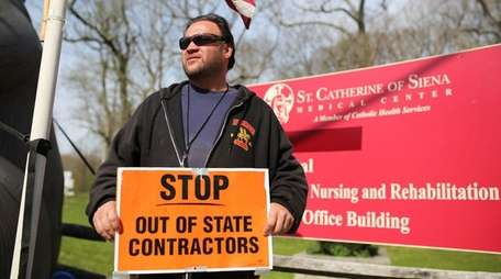 Representing Local Union #66, Philip Sgambati pickets outside