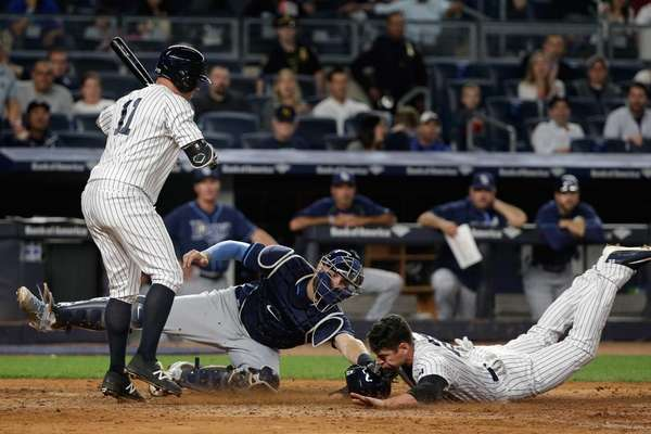 New York Yankees' Jacoby Ellsbury slides under the