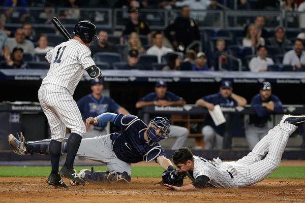 New York Yankees' Jacoby Ellsbury slides under the
