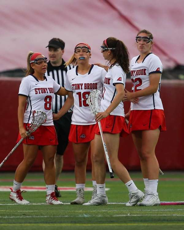 Stony Brook's Courtney Murphy #18 is congratulated by