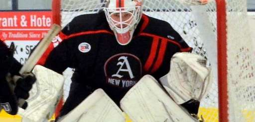 Former New York Aviators goaltender Stephen Mundinger stands