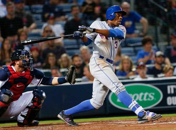 New York Mets' Curtis Granderson follows through with