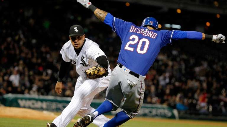 Ian Desmond of the Texas Rangers attempts to