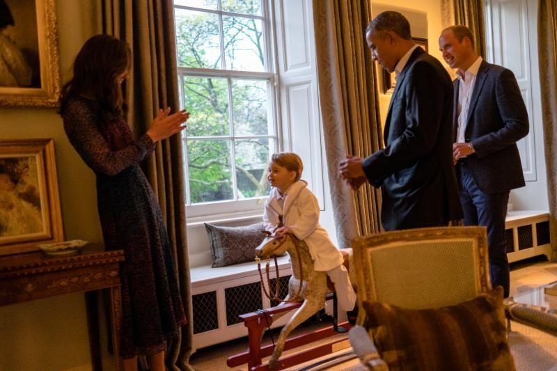 Prince George, center, talks to his mum, Kate,