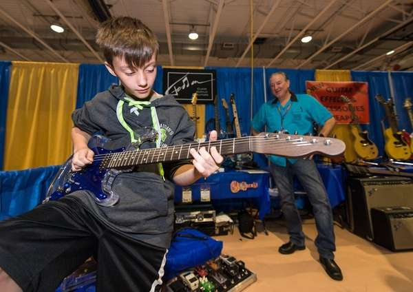 Michael Judge, 9, of Mineola tries out an