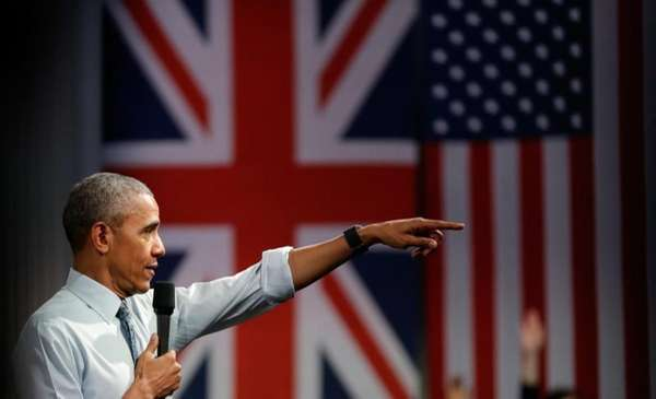 President Barack Obama takes a question as he