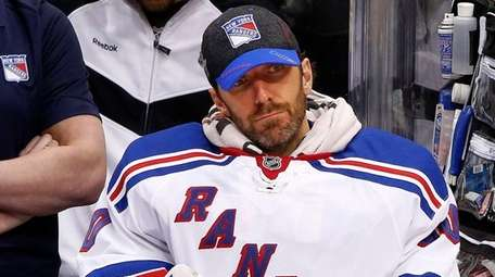 New York Rangers goalie Henrik Lundqvist sits on