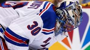 New York Rangers goalie Henrik Lundqvist (30) collects