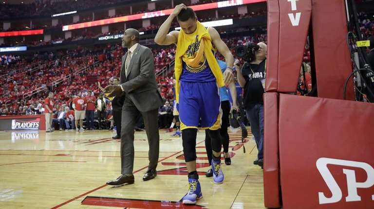 The Golden State Warriors' Stephen Curry heads off