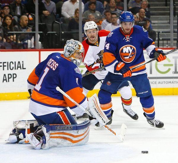 Thomas Greiss of the New York Islanders defends