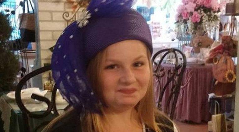 Kidsday reporter Ella Kurth tries on a hat