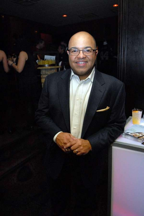 Mike Tirico attends the 2012 Jaws Cigar party