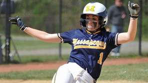 Amanda Considine of Massapequa slides home safely in