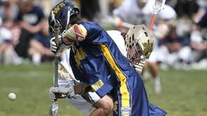 Shoreham-Wading River's Joseph Miller (8) wins a face-off