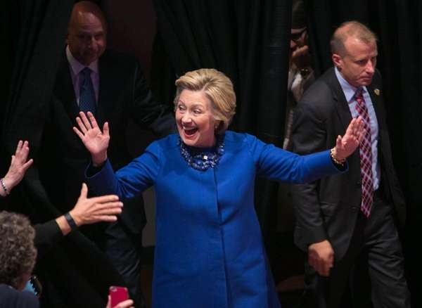 Democratic presidential candidate Hillary Clinton waves to supporters