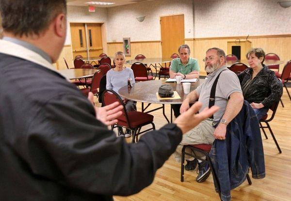 Members of the Farmingville Residents Association listen as