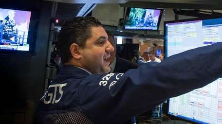 A trader works on the floor of