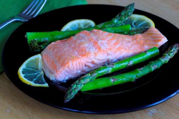 Salmon is brushed with a maple-mustard mixture and