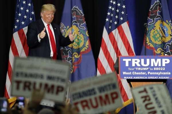 Republican presidential candidate Donald Trump greets supporters as