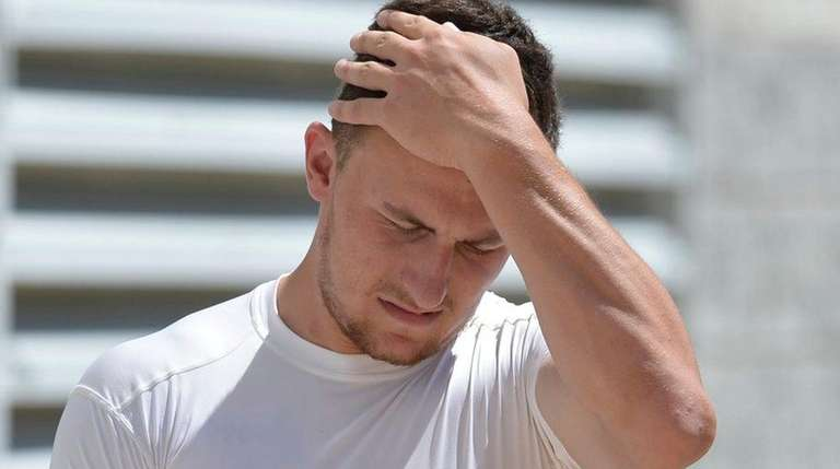 Cleveland Browns quarterback Johnny Manziel reacts after practice