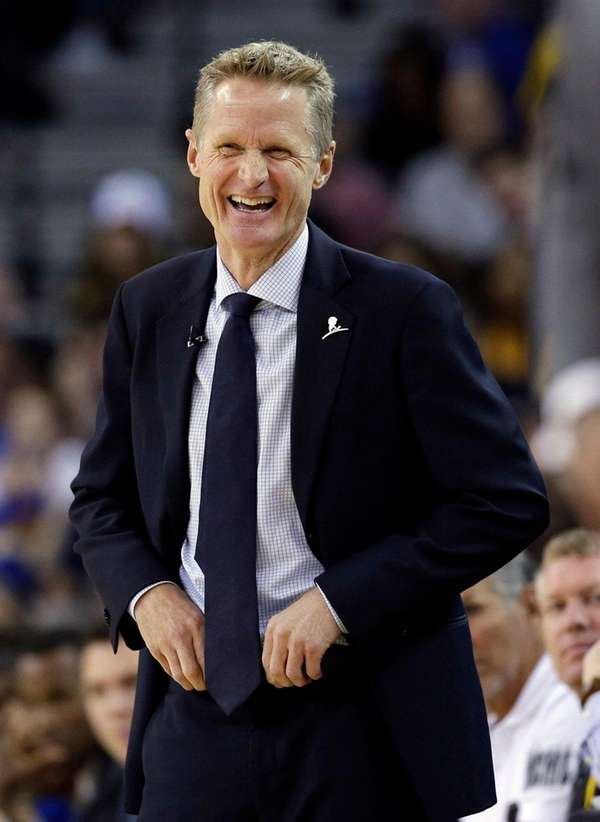 Golden State Warriors coach Steve Kerr smiles