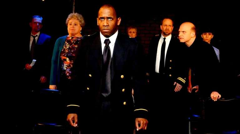 Dondi Rollins Jr., center, plays the pilot in