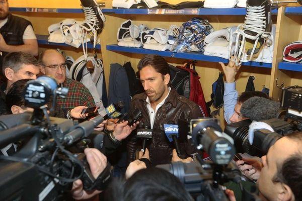 Goaltender Henrik Lundqvist speaks to the media during
