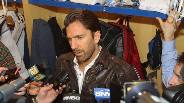 Goaltender Henrik Lundqvist speaks to the media during