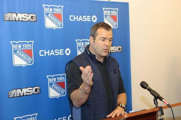 Rangers coach Alain Vigneault speaks to the media
