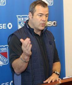 Rangers coach Alain Vigneault speaks to the media