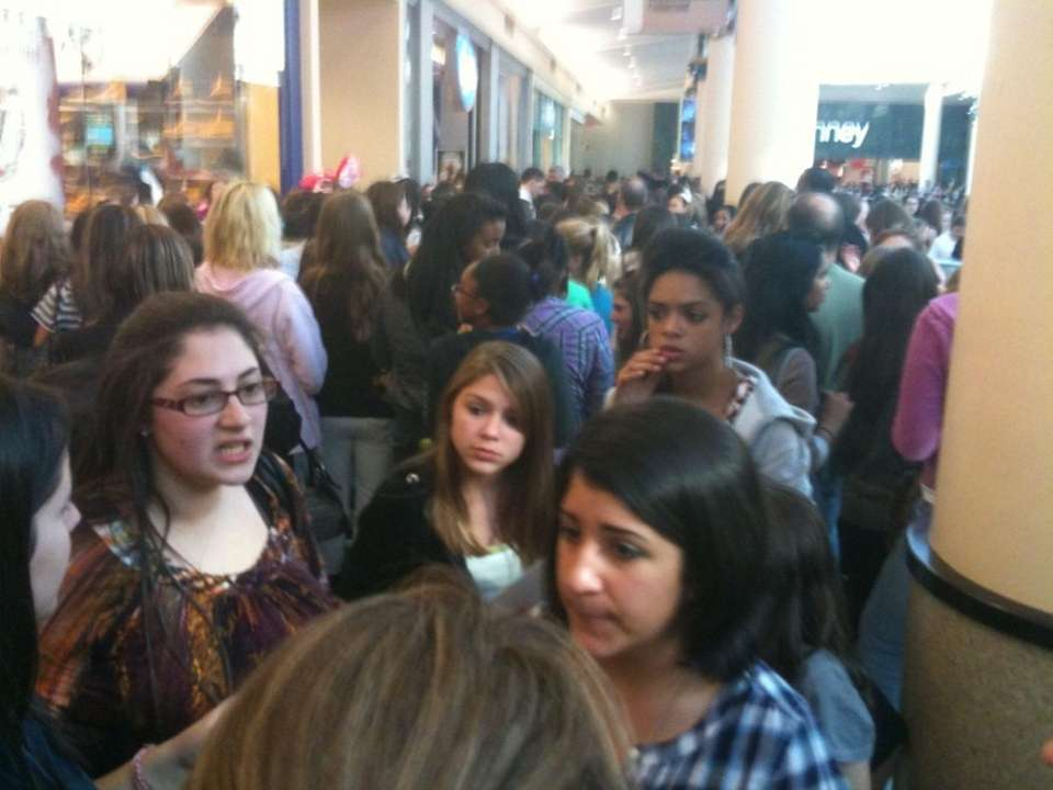 Scene inside Roosevelt Field Mall of fans waiting