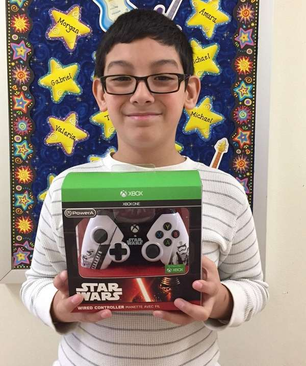 Kidsday reporter Marcos Quiroz with the Xbox One