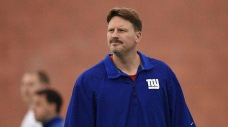New York Giants head coach Ben McAdoo observes