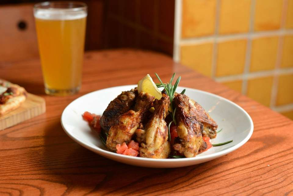 Grilled Tuscan wings, marinated in lemon and rosemary