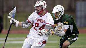 Connetquot's Jake Piccininni (24) is marked by Ward