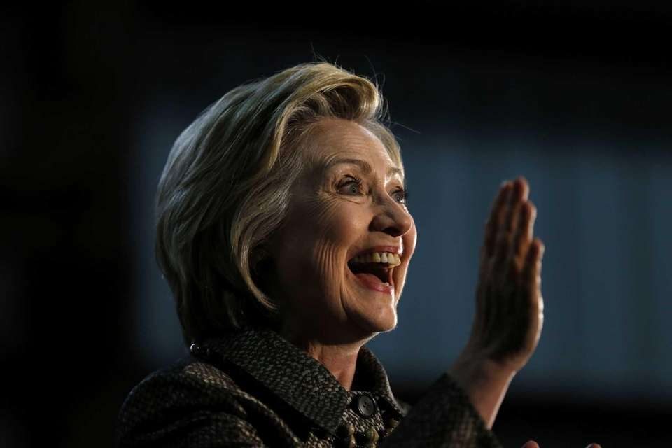 Democratic presidential candidate Hillary Clinton waves during a