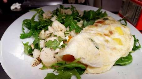 Omelettes, salads, sandwiches and sweets are featured on