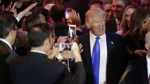 Republican presidential candidate Donald Trump makes his way