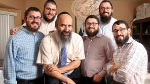 Rabbi Tuvia Teldon, 64, center, is surrounded