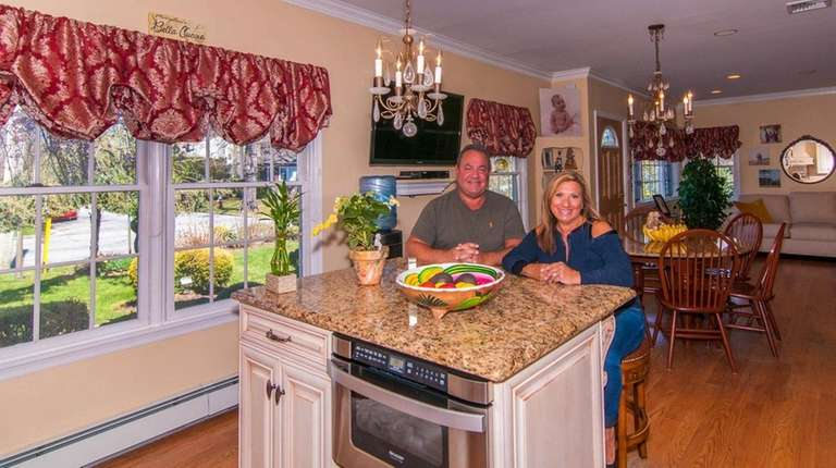Maryellen and Hank Kobrin in the kitchen of
