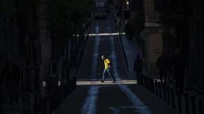 People walk along streets in Madrid on Tuesday,
