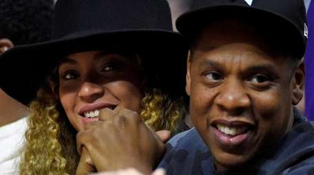 Beyonce and Jay Z, shown at an NBA