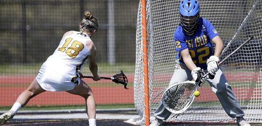 West Islip's goalie Lauren DiStefano (22) stops a