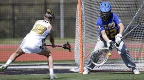 West Islip's goalie Lauren DiStefano (22) stops a