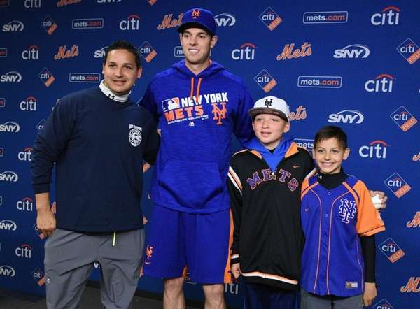 New York Mets pitcher Steven Matz poses for